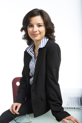 Business woman sitting on a table